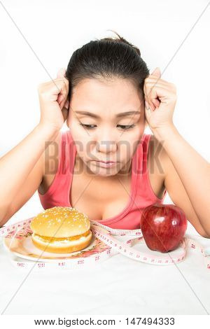asian woman with red apple and hamburger
