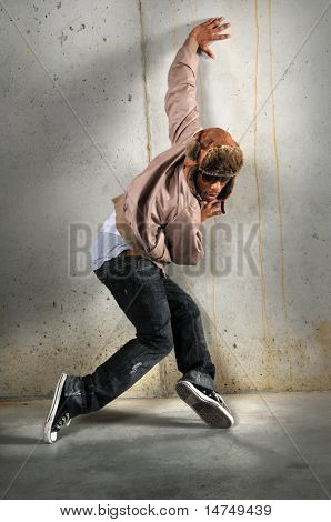 African American hip hop dancer over a grunge background