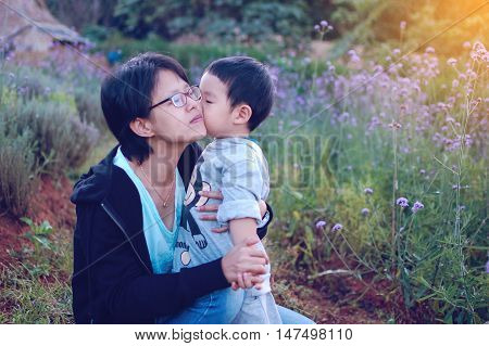 Son kissing his mum, mother, kiss, child,