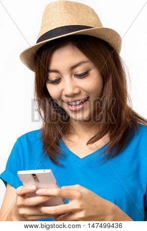 asian woman using her mobile phone on white background