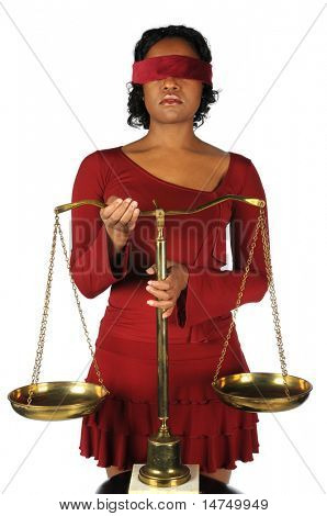 African American woman holding scales