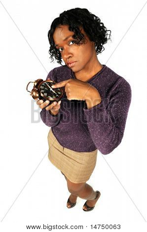 African American woman pointing to alarm clock