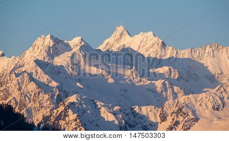 Early morning sun casts shadows on the East end of the Mont Blanc massif in the Swiss/French alps.