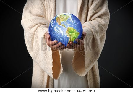 Hands of Jesus holding world showing the Americas over dark background