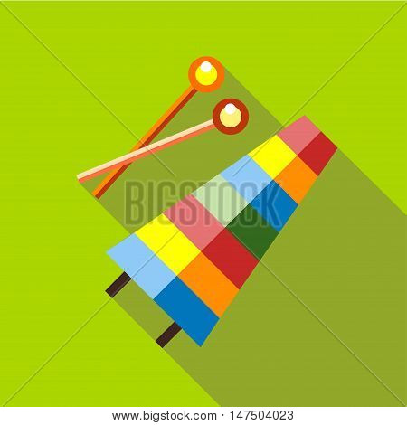 Children's toy musical xylophone on a red background. Picture style flat