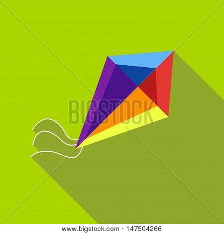 A child's toy a kite on a bright green background. Picture style flat