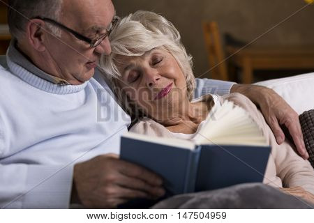 Two Retired People Sitting On The Couch