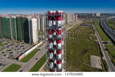 Aerial view of new modern gas boiler house in a residential area of the city, district heating plant chimney, modular boiler. St. Petersburg, Russia, 2016