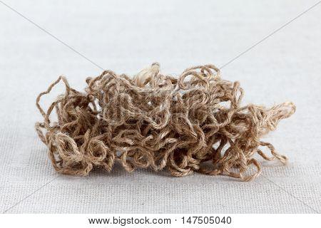 Tangle of coarse jute rope on textile background burlap