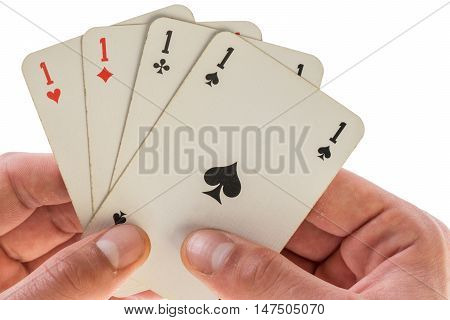 man holding gaming cards agaisnt white four aces