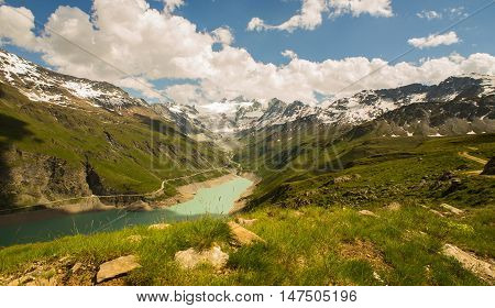 Looking across the waters of Lac de Moiry to the Glacier de Moiry and the high peaks of the pennine alps. Grand Cornier and Dent Blanche are the prominent peaks.