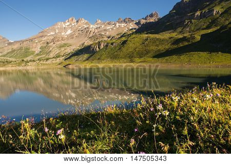 Lac de Salanfe in the foreground and the South facing slopes of Dents du Midi in the background.