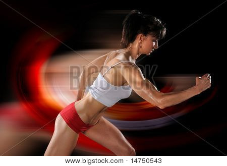 Female athlete running isolated over black background
