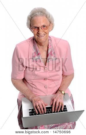 Portrait of elderly woman typing on laptop over white background
