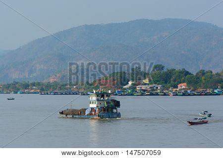 CHIANGRAI THAILAND - MAY 17 : Chinese transportation and some small boats on Mae khong riverborder of Thailand and Lao at Golden triangle Chiang saen Chiangrai Thailand on May 17 2016