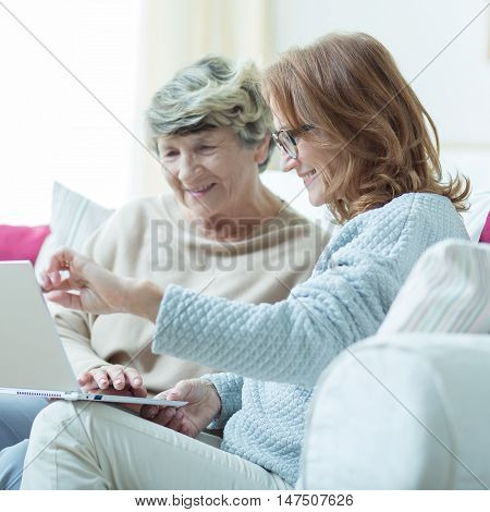 Kind Carer Teaching Old Lady