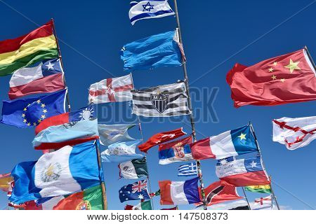 UYUNI BOLIVIA - August 28 2016. Flags of various nations in Salar de Uyuni Bolivia on August 28 2016. Salar de Uyuni is the worlds largest salt flat at 10582 square kilometres.