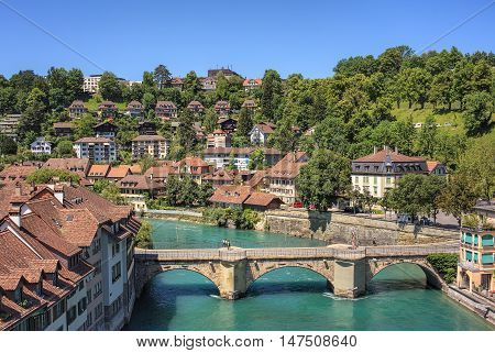Bern, Switzerland - 11 June, 2014: view on the city with the Aare river in summertime. The city of Bern is the capital of Switzerland and the fourth most populous city in the country.