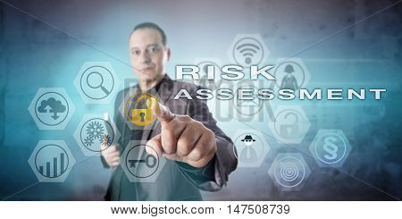 Kind looking but intent corporate strategist initiating RISK ASSESSMENT onscreen via touch. Business concept involving hazard analysis technology and probability assessment and safety engineering.