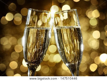 Flutes of champagne in holiday setting. Champagne glass toast.
