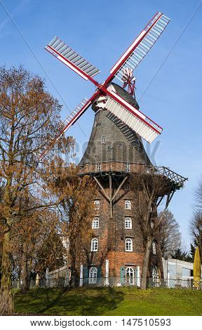 Historic windmill in a park of German city Bremen.