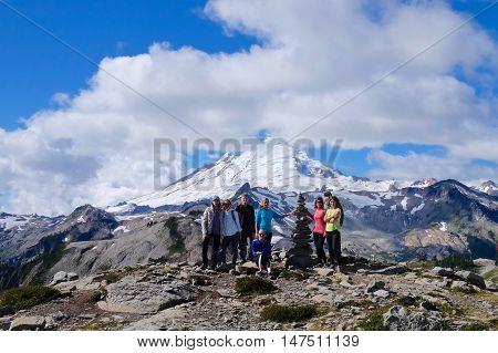 Artist Point WA/USA - September 11 2016: Group of hikers from Vancouver BC pose at the view point of Mount Shuksan on September 11 2016. All people are members of meetup group