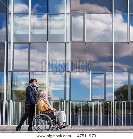 Disabled Grandfather And His Grandchild
