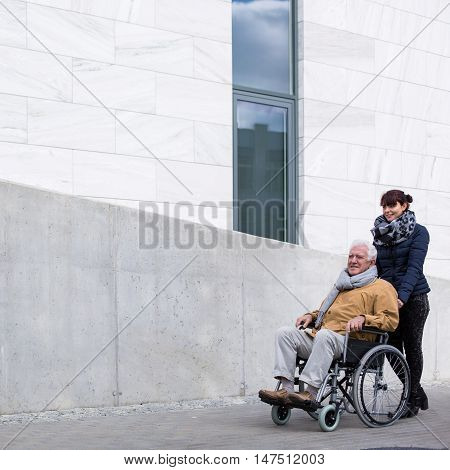 Man With Paralysis And Carer