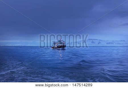 Ship in north twilight at winter evening