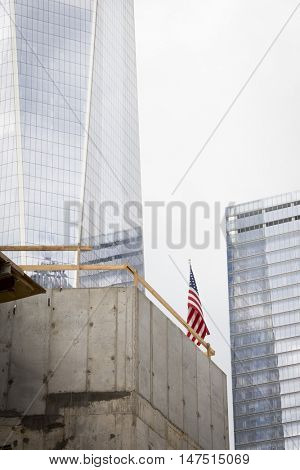 NEW YORK - SEPT 9 2016: American Flag displayed in the Liberty Park construction site near One World Trade Center building known as the Freedom Tower on the 15th anniversary of the terrorist attacks.
