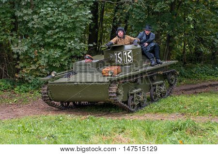 Gatchina, Russia - September 11, 2016: The historical reconstruction of World War II. Lightweight floating tank T-37A. Tank returns from exploration. On the armor is a military korresondent.