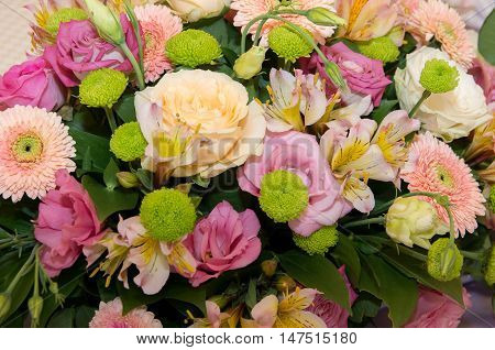 Chrysanthemums and roses. Bouquet of chrysanthemums and roses.