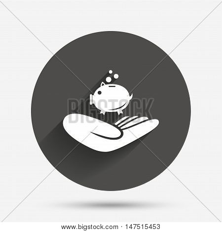 Donation hand sign icon. Hand holds Piggy bank. Charity or endowment symbol. Human helping hand palm. Circle flat button with shadow. Vector