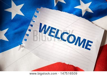 Welcome on notepaper and the US flag