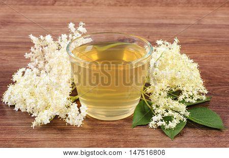 Fresh Healthy Juice And Elderberry Flowers On Rustic Board