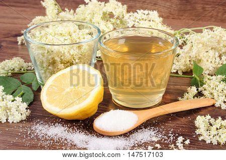 Flowers And Juice Of Elderberry, Ingredients For Preparing Beverage On Rustic Board