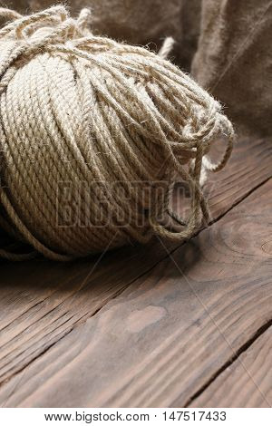 hank jute rope close-up on a background of wooden planks