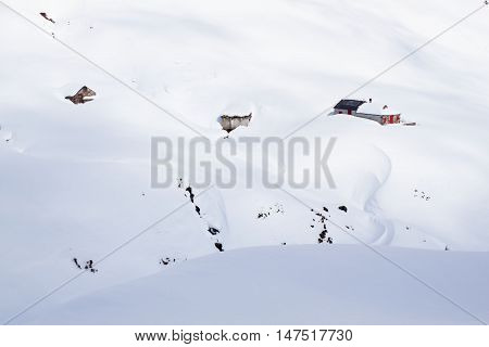 Huts In The Mountain Covered Of Snow