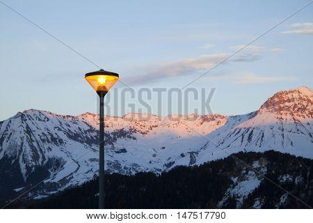 Lamppost Turn On In A Winter Night