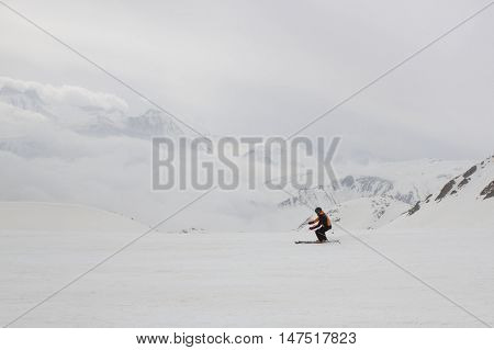 guy skiing down the mountain in winter