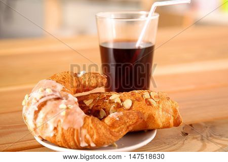 Croissant in the plate on the table.