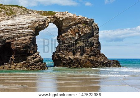 Natural Arch On Beach.