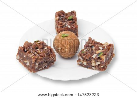 Indian sweets on a plate isolated over white
