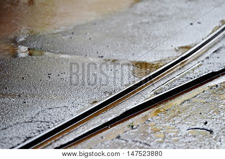 Detail shot with tramway track during rainfall