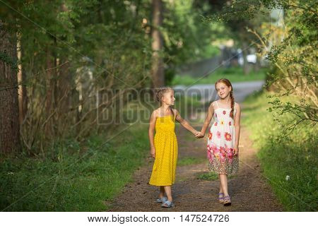 Two little girls go for the handle on the green alley.