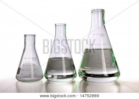 Laboratory flasks over white background with table reflections - With clipping path