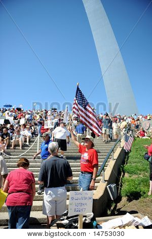 SAINT LOUIS, MISSOURI - SEPTEMBER 12: Man holding flag at rally of the Tea Party Patriots in Downtown Saint Louis under the Arch, on September 12, 2010