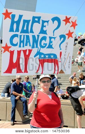 SAINT LOUIS, MISSOURI - SEPTEMBER 12: Woman holding sign at rally of the Tea Party Patriots in Downtown Saint Louis under the Arch, on September 12, 2010