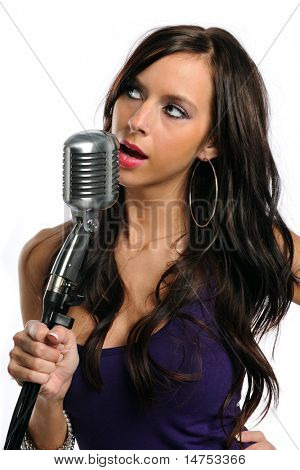 Portrait of beautiful woman singing into a microphone