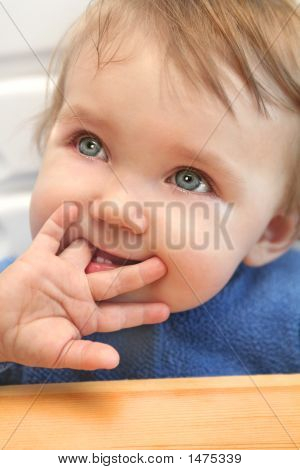 Baby Chewing On A Finger